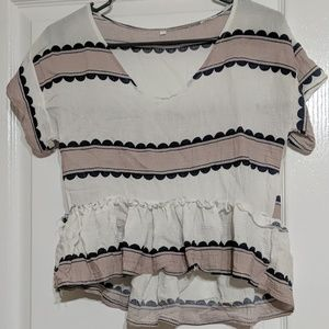 Peplum see through shirt with pink and blue.